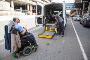 Access customer prepares to board service provided by Metro