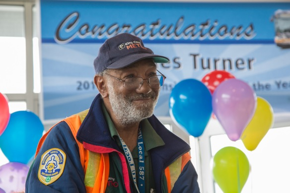 James Turner smiles as he is praised and honored with the Transit Operator of the Year award Aug. 17, 2017.